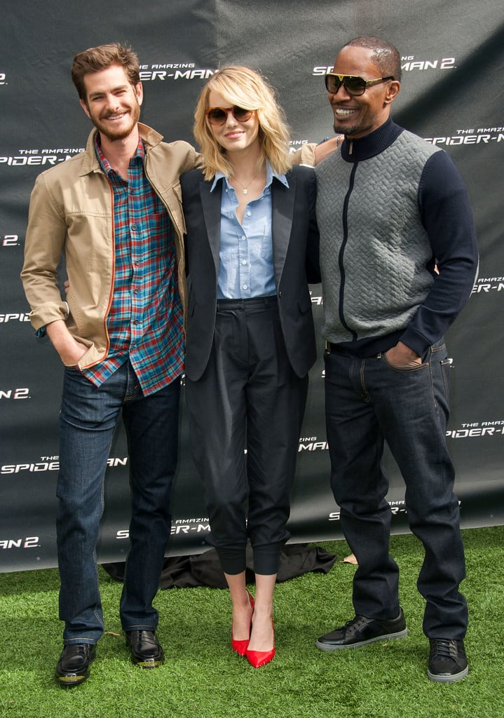 Emma Stone and Andrew Garfield goofed around at an LA photocall for The Amazing Spider-Man 2 on Saturday, sharing sweet glances throughout a fan event at Sony Pictures Studios. While posing for pictures, Andrew threw a t-shirt over his head, joking around with the fans. Jamie Foxx had fun with some of the kids, too, including his daughter Annalise Bishop, who joined him at the event. Production for the film wrapped this past June, and while Andrew and Emma shared some on-camera PDA, there was plenty of off-camera cuteness with Andrew hanging out on set in his Spider-Man suit. Since filming ended, Emma and Andrew were spotted on a trip to London, and she spent the second half of the Summer filming Woody Allen's latest movie, Magic in the Moonlight, with Colin Firth.