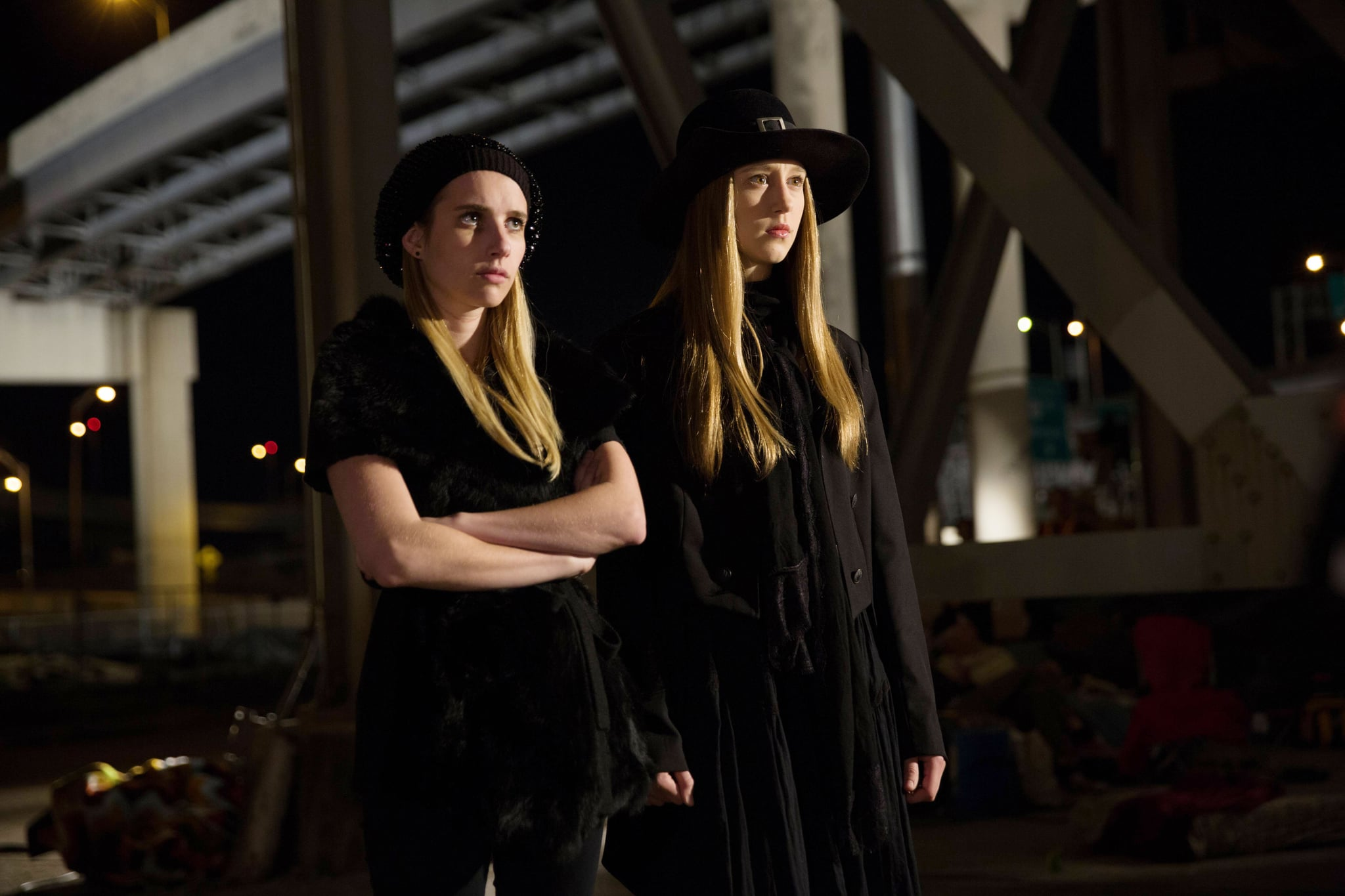 AMERICAN HORROR STORY: COVEN, l-r: Emma Roberts, Taissa Farmiga in 'The Sacred Taking' (Season 3, Episode 8, aired December 4, 2013). ph: Michele K. Short/FX Networks/courtesy Everett Collection