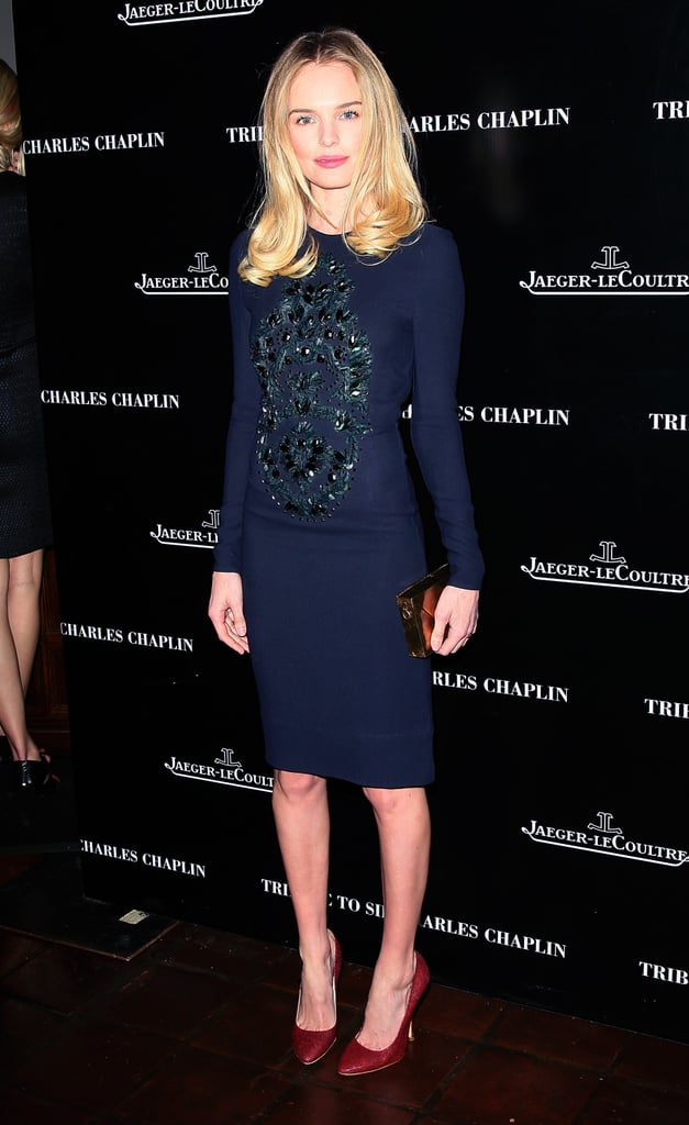 Kate Bosworth paired a blue dress with burgundy heels.