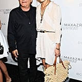Olivia Palermo posed with designer Max Azria backstage at the BCBG runway show on Thursday.