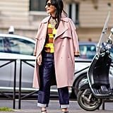 With a Pink Coat, a Colorful Top, and Mary Jane Pumps