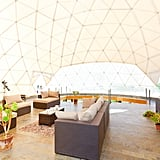 For a little less than $200 a night, you can stay in one of the two-story geodesic domes complete with a living room, bathroom, and main bedroom with a detachable roof over it.