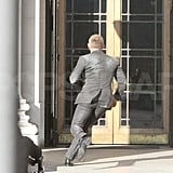 Daniel Craig running on set.