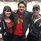 Christian Madsen caught a hockey game offset with costars Amy C. Newbold and Theo James. (Note Four's Divergent tattoo on Theo's neck!) Source: Twitter user cmadsen8