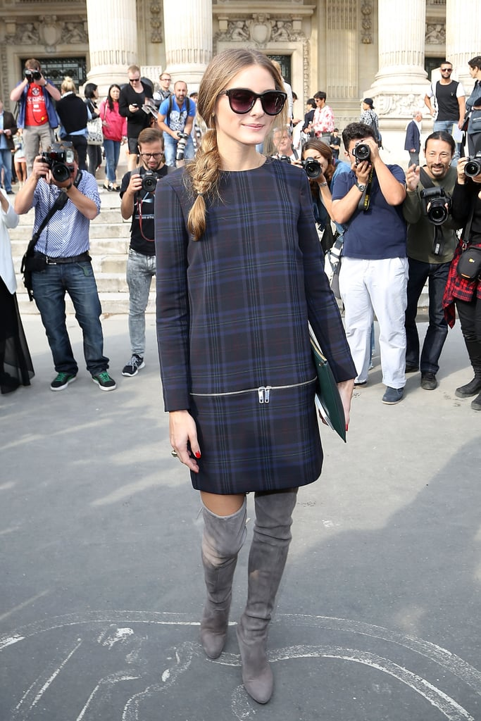 At the Carven show in Sept. 2013, Olivia gave her plaid Zara dress a bold finish with over-the-knee boots.