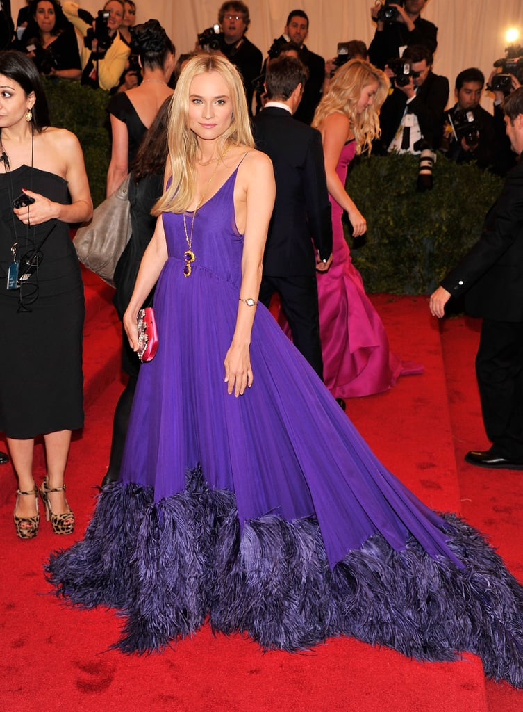 Diane Kruger hit the red carpet at the Met Gala in NYC tonight wearing a flowy, purple gown by Prada. She was one of many stars in couture frocks for the black-tie soiree, which also honored the famous design house and the Met's exhibit Schiaparelli and Prada: Impossible Conversations. Tell us which dress was your favorite by voting on Fab's Met Gala fashion polls!