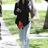 Kendall took her memorable Martine Rose waist pack out for another run, styling it with Yeezy Season 5 jeans, a baggy shirt, sunglasses, and her Yeezy Wave Runner sneakers in LA.
