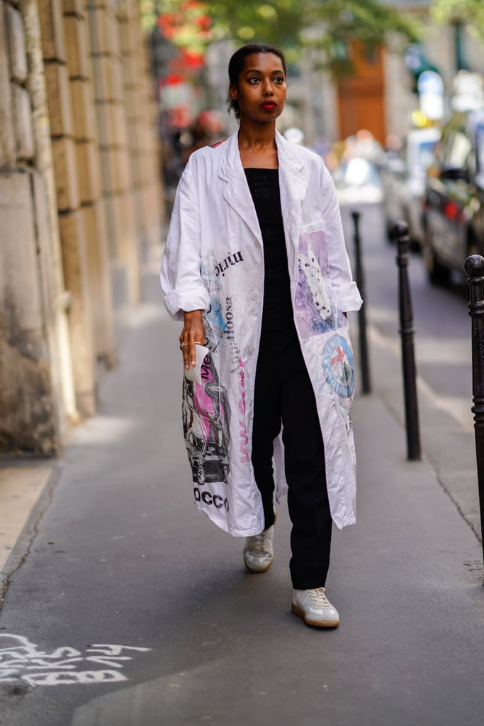 As long as the hemline stays well above your ankles, a classic pair of black trousers and a duster coat makes for a no-fuss, no-fail look.
