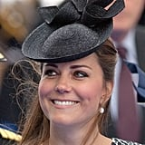 The Duchess topped her animal print dress with a solid Sylvia Fletcher hat for Lock & Co.