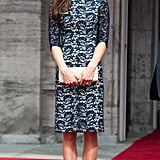 Kate's lace Erdem dress is a must have for all ladies who attend the occasional formal event. She styled her afternoon outfit with a cream clutch and matching L.K. Bennett pumps, a light touch to speak to the hour.