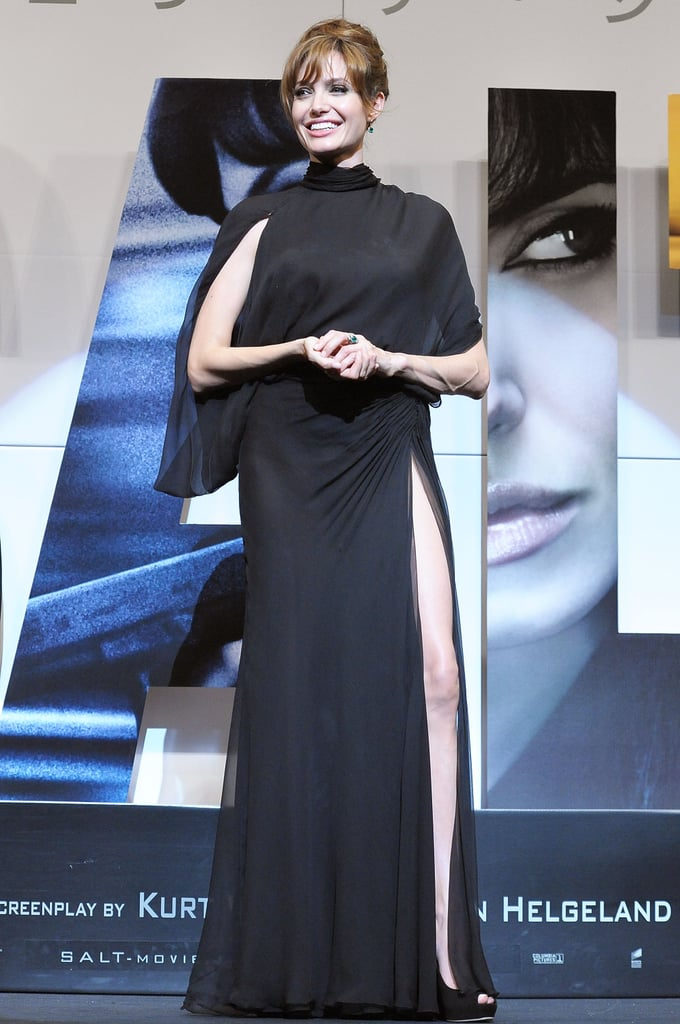 For the Salt Premiere in Japan in 2010, Angelina wore Atelier Versace A/W 2000 black chiffon high neck gown with a thigh-high slit and open back.