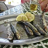 Serve with a splash of lemon juice and a cold beer. To enjoy, pull pieces of the fish's flesh off with your fingers. Eat the meat underneath. Discard the bone, head, and guts.