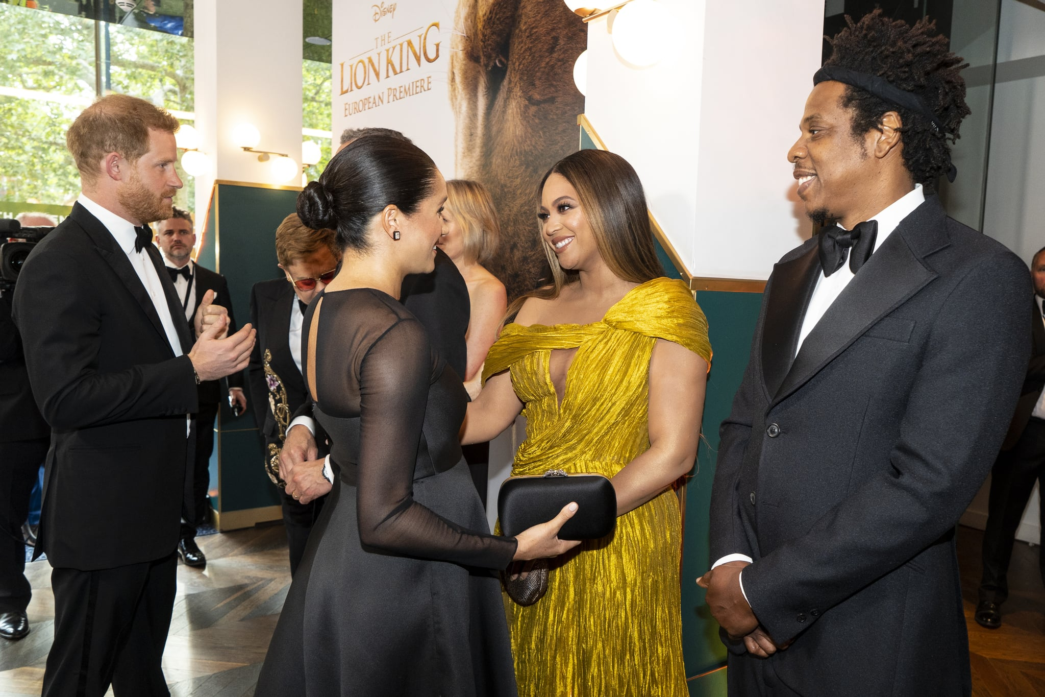 LONDON, ENGLAND - JULY 14: Prince Harry, Duke of Sussex (L) and Meghan, Duchess of Sussex (2nd L) meets cast and crew, including Beyonce Knowles-Carter (C) Jay-Z (R) as they attend the European Premiere of Disney's
