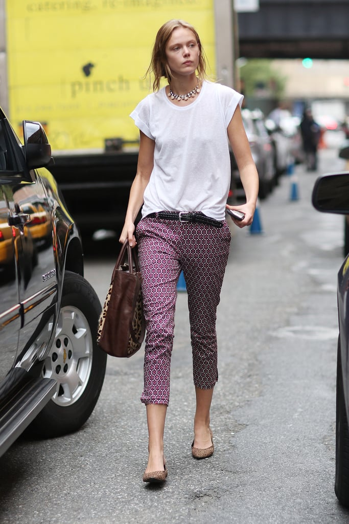 Printed pants got a relaxed finish with a slouchy white tee, then a touch of sparkle on this styler's statement necklace. Source: Greg Kessler