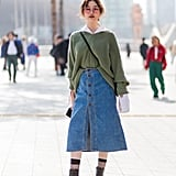 Tuck a Comfy Sweater Into a Button-Front Denim Skirt