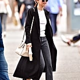A good coat instantly dresses up any outfit and Selena's pinstripe duster Norma Kamali trench did exactly that. She wore it with a pair of cropped black jeans, a t-shirt, and chunky leather loafers by Tod's.