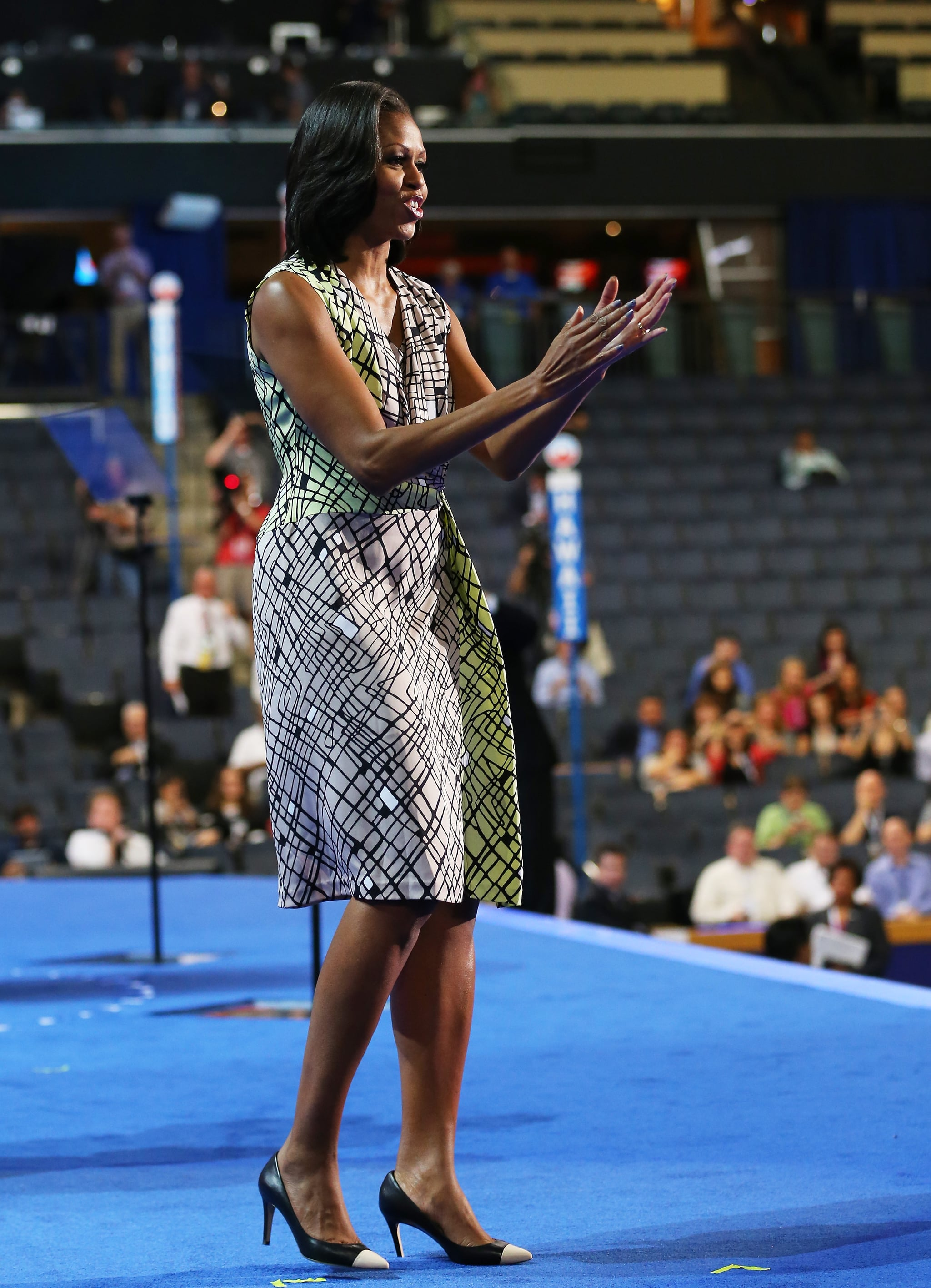 During a soundcheck pre-DNC festivities, the FLOTUS was spotted in a cool tan-and-lime abstract-printed Diane von Furstenberg dress with cap-toe Giuseppe Zanotti pumps.