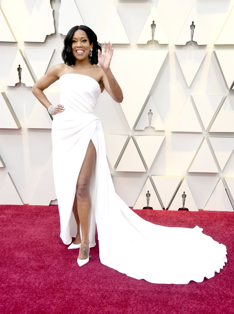 Regina King looked like actual royalty as she attended the Oscars on Sunday night. The If Beale Street Could Talk star, who is nominated for best supporting actress, practically made our jaws drop to the ground when she stepped out on the red carpet in a gorgeous white gown with a thigh-high slit. While Regina brought her son, Ian Alexander, Jr. as her date to the Golden Globes, this time around she brought her sweet mother, Gloria, along for the big night. Bask in her stunning night ahead!       Related:                                                                                                           Every Glamorous Gown From the 2019 Oscars