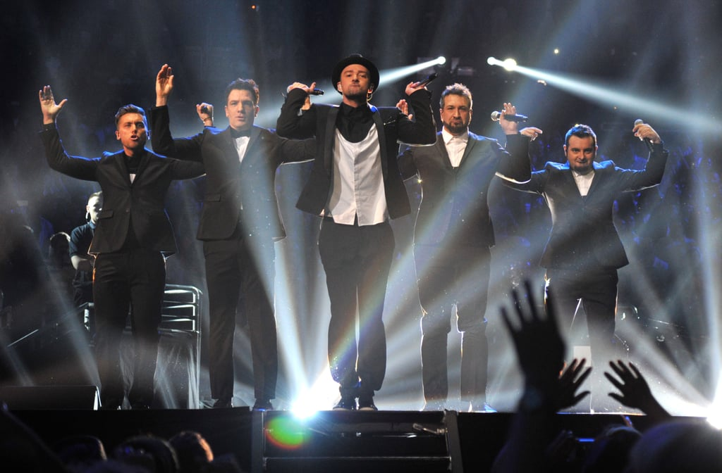 """It happened, it really happened! Rumors of an *NSYNC reunion started swirling earlier this week, and at tonight's VMAs, the '90s boy band took the stage together for the first time in 10 years. A collective squeal from *NSYNC fangirls everywhere could be heard (or at least imagined) as Justin Timberlake was joined by his former bandmates JC Chasez, Lance Bass, Joey Fatone, and Chris Kirkpatrick for """"Girlfriend"""" and """"Bye Bye Bye."""" Although Justin isn't sporting his curls anymore and the group didn't step out in the '90s ensembles that tore up our hearts back in the day, fans did have a chance to see the group channel their most popular videos before Jimmy Fallon presented Justin with the Michael Jackson Video Vanguard Award. Weigh in on their performance and see all the pictures from the group's performance now!"""