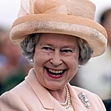 Queen Elizabeth II watches a polo match in 2000