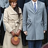 For the Christmas Day church service in Sandringham, Harry wore a grey coat, while Meghan opted for a camel Sentaler piece, which she accessorised with a brown fascinator, matching gloves, over-the-knee Stuart Weitzman boots, and an eye-catching Chloé bag.