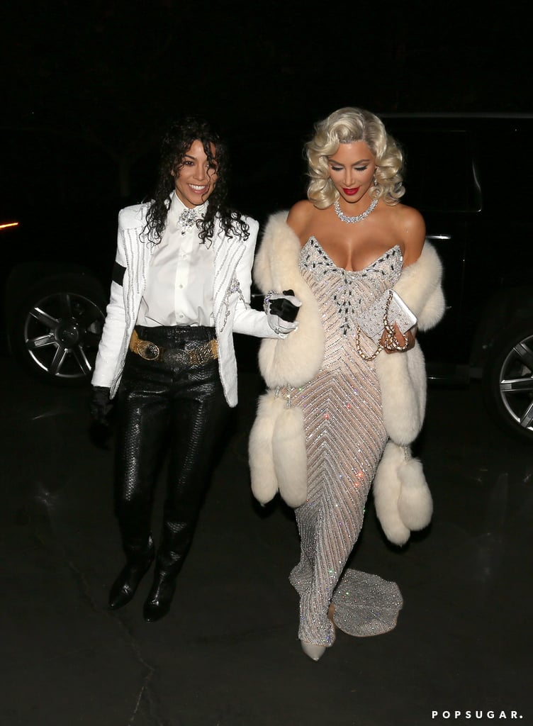 Kim Kardashian has been paying homage to her favorite icons this Halloween, and on Saturday, her sister Kourtney also got in on the fun. The two dressed up as Madonna and Michael Jackson from the 1991 Academy Awards for a party in Bel Air. While Kim looked glamorous in a shimmery dress and blonde wig, Kourtney completely nailed her tribute to the King of Pop by donning a white jacket, black leather pants, matching gloves, and wet curly hair. From her spot-on Cher costume to her somewhat controversial Aaliyah outfit, it's clear that Kim is taking her costume game very seriously this year. Hopefully she will do a family costume with her kids before Oct. 31st!      Related:                                                                                                           These 2017 Celebrity Halloween Costumes Will Either Make You LOL or Scare the Sh*t Out of You