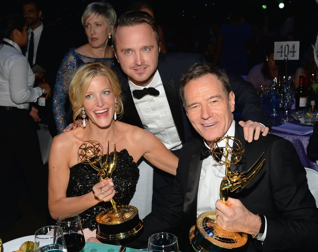 Aaron Paul posted with Anna Gunn, Bryan Cranston, and their matching statuettes at the Governors Ball.