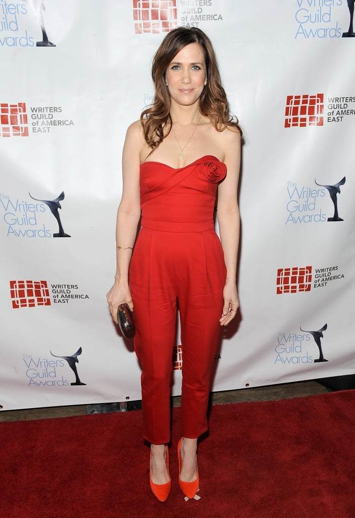 Kristen Wiig showed off the evening version of the jumpsuit in scarlet-red Valentino with a sexier strapless neckline.