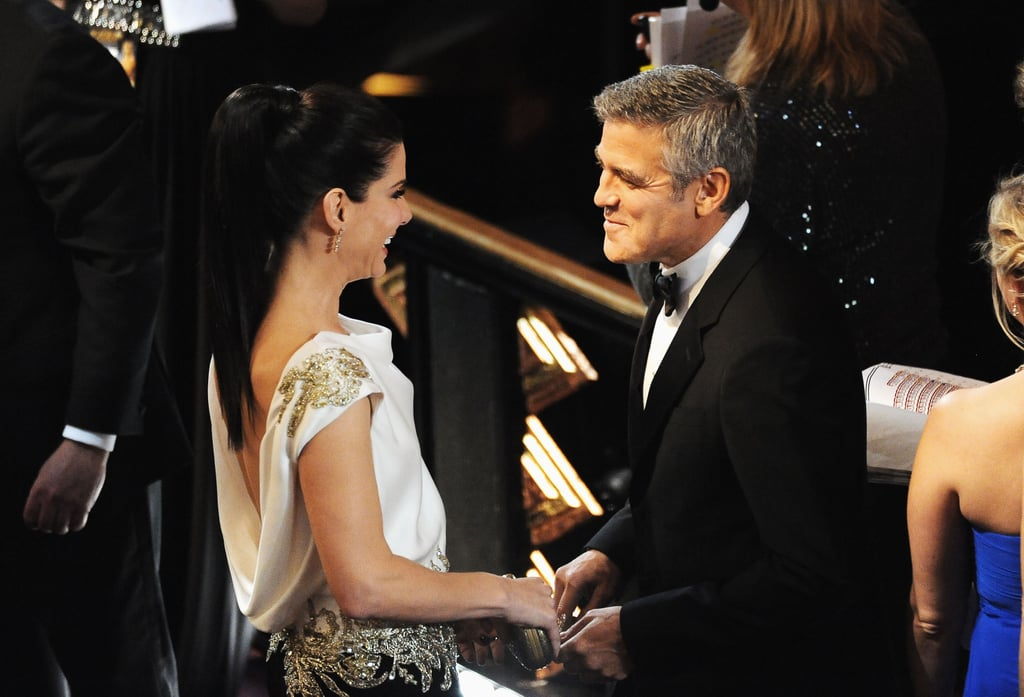 Sandra Bullock and George Clooney exchanged pleasantries at the February 2012 Academy Awards in LA.