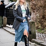 Style a Slitted Skirt With Knee-High Boots, a Graphic Tee, and a Blazer