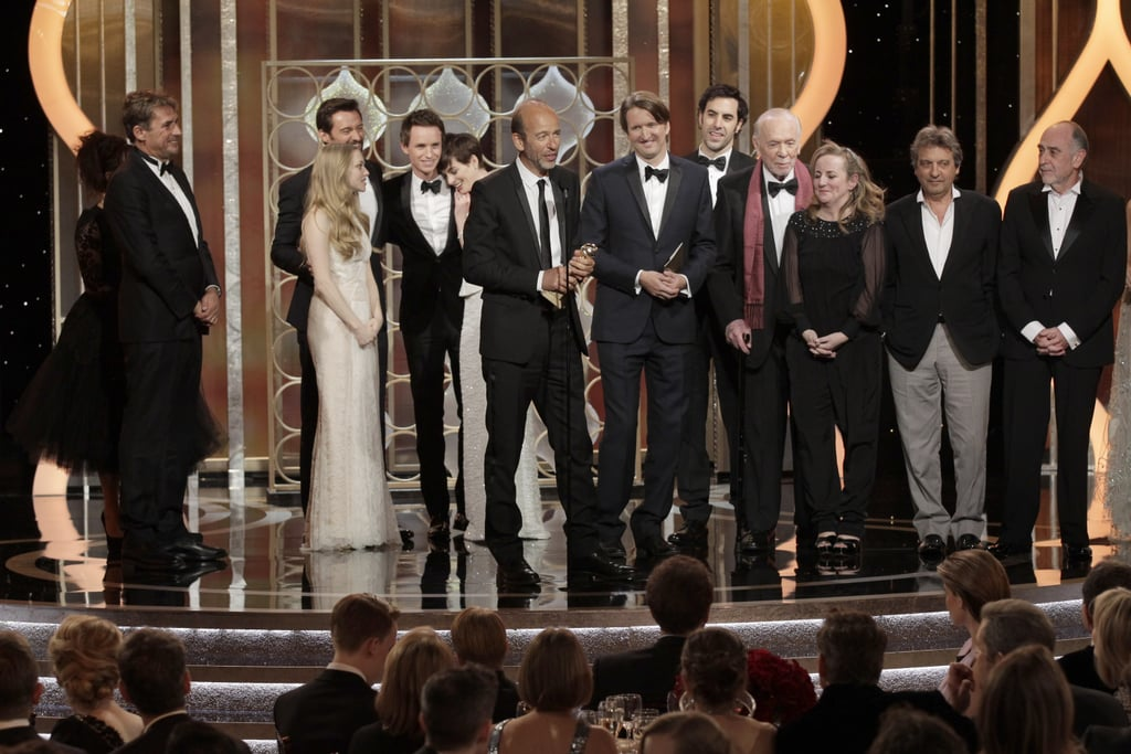 The cast of Les Misérables got emotional while accepting the award for best picture, comedy or musical.