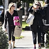 Reese Witherspoon wore yoga pants and carried an Anya Hindmarch bag.