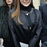 Elizabeth Olsen smiled as she made her way into the Louis Vuitton presentation on Wednesday in Paris.