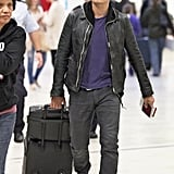 Orlando Bloom toted a suitcase.