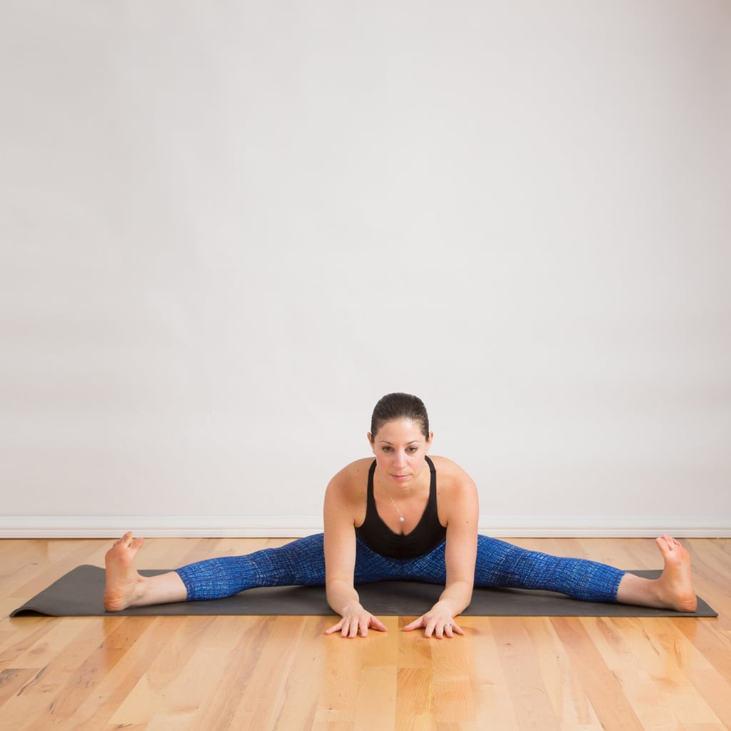 Seated straddle how to do the splits popsugar fitness for Floor yoga stretches