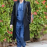 She might've been pushing the envelope with her Hatch denim jumpsuit, but that Smythe coat was all business! The sharp lapels were in line with a tuxedo blazer, though this version reached down to hit at the knee.