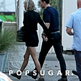 Taylor couldn't help but stay close to Tom.