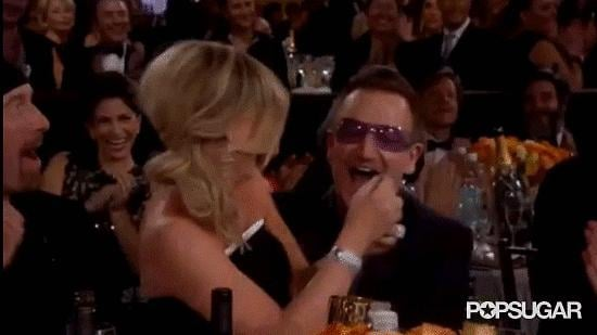Golden Globes cohost Amy Poehler made out with Bono at the show. NBD.
