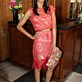 Zoe Saldana accessorized with a bold Jimmy Choo clutch for a sweet-cum-cool cocktail style.