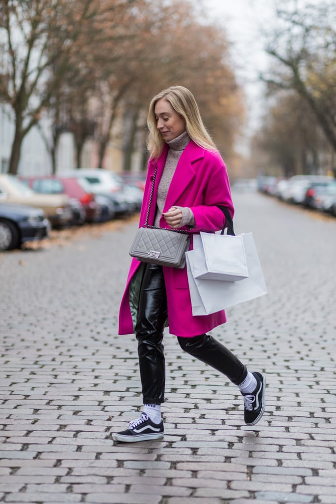 With a Bright Coat, Sweater, and Leather Pants