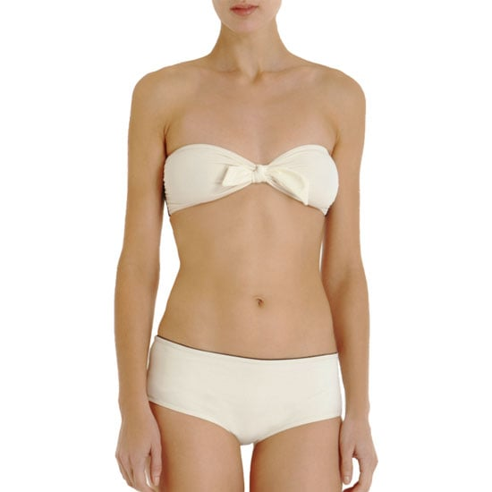 Phillip Lim is a master of minimalism — this suit has just the right amount of interest with a bow-front bandeau and boy-short bottoms.  3.1 Phillip Lim Bow Bandeau Bikini ($250)
