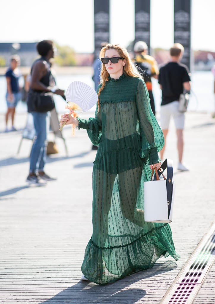 A guest going braless in a sheer green dress with black shorts.