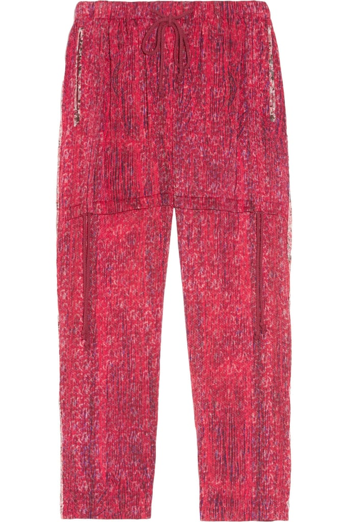 Give these silky cropped trousers a bohemian twist and pair it with fringed sandals and a loose tee.   Edun Cropped Printed Stretch-Silk Pants ($300)