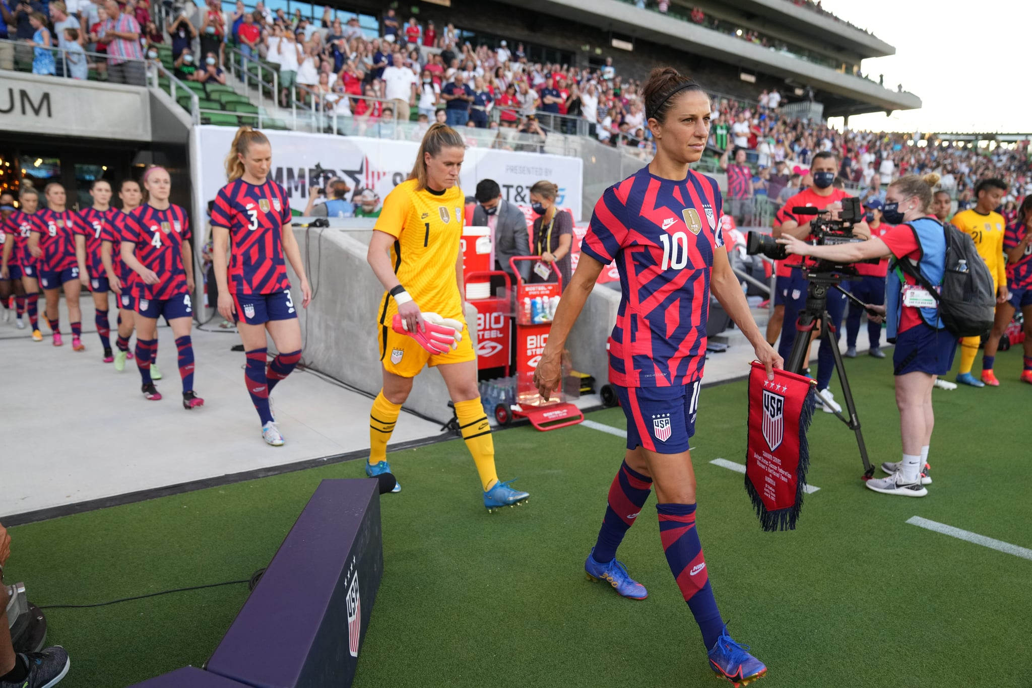 AUSTIN, TX - JUNE 16: Carli Lloyd #10 of the United States receiving her award for 300 career caps during a game between Nigeria and USWNT at Q2 Stadium on June 16, 2021 in Austin, Texas. (Photo by Brad Smith/ISI Photos/Getty Images)