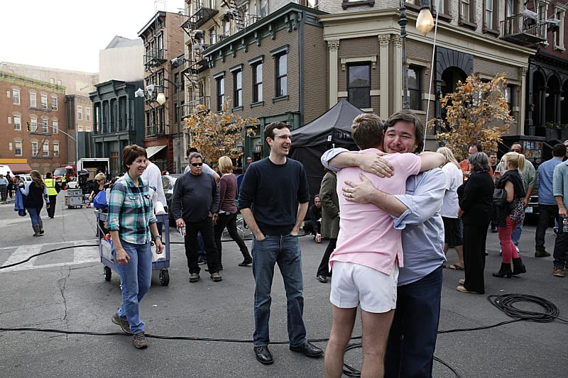 The crew hugged at the end of filming on How I Met Your Mother's outdoor set.