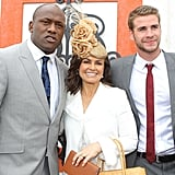 Sandwiched between Wendell Sailor and Liam Hemsworth at the Melbourne Cup in 2010.