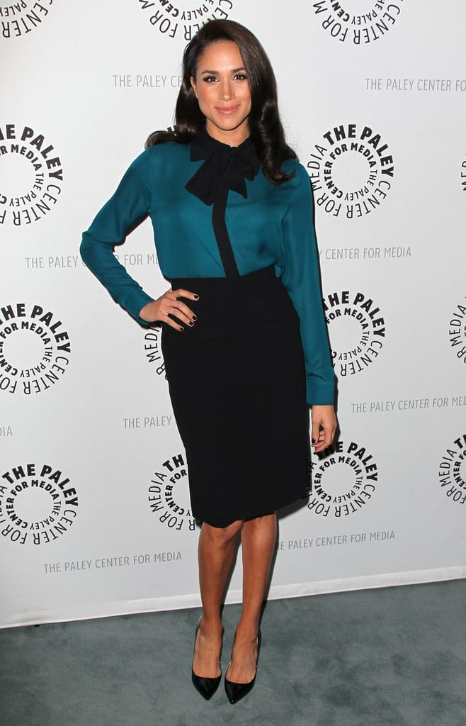 For an evening with her Suits co-stars, Meghan opted for a pussy-bow blouse and black pencil skirt.