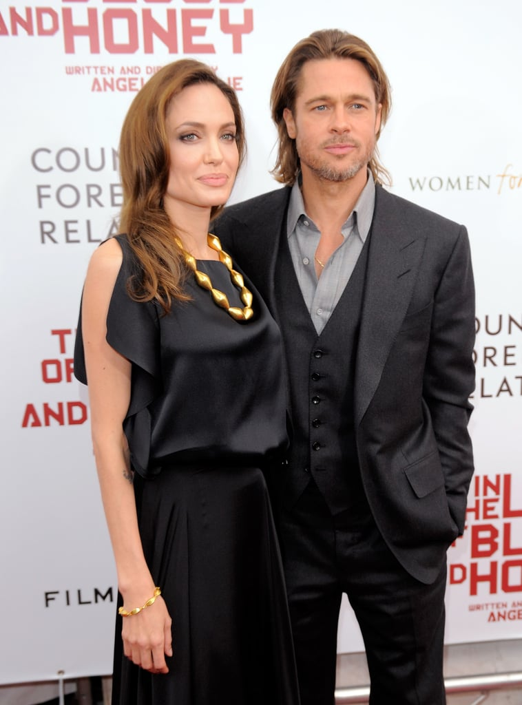 Angelina Jolie Strikes a Sexy Pose With Brad Pitt at Her NYC Premiere