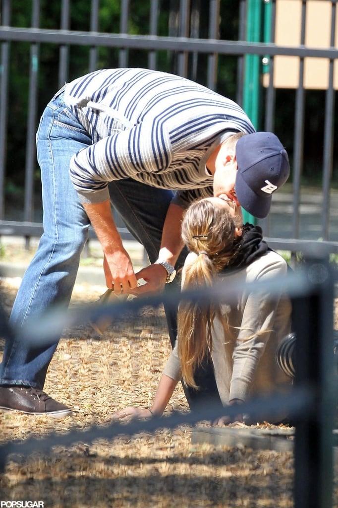 Tom Brady and Gisele Bundchen kissed in the sandbox.