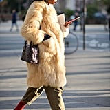 Just add a pair of bright socks to slides, then cover up accordingly with a chic coat à la Julia Sarr Jamois.